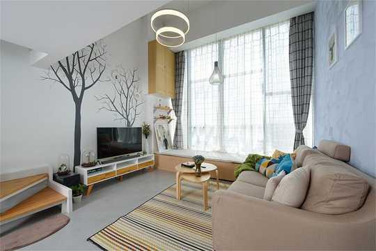 蓝色硅藻泥的沙发背景墙搭配灰色的地砖