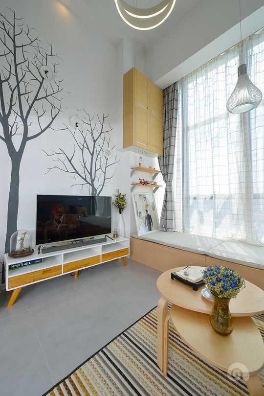 蓝色硅藻泥的沙发背景墙搭配灰色